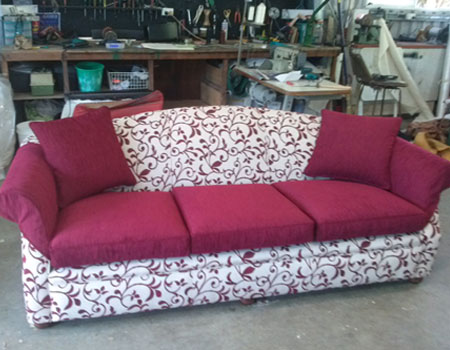 Couch reupholstered Cairns after