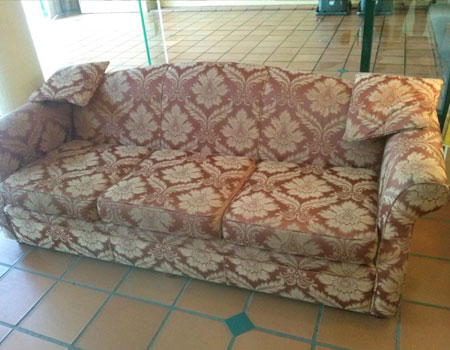 Couch reupholstered Cairns before