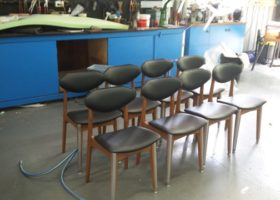 Set of re-upholstered black chairs